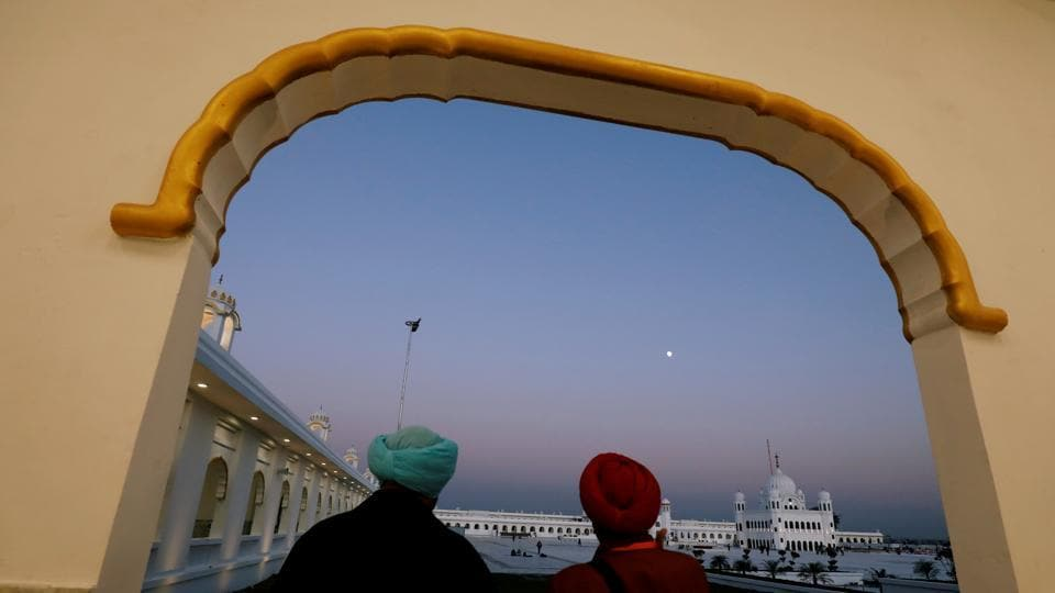 PM Narendra Modi on Saturday flagged off the first batch of over 500 Indian pilgrims that traveled to Gurdwara Darbar Sahib of Pakistan's Punjab province through the Kartarpur Corridor which was opened on the occasion of 550th birth anniversary of Sikhism founder Guru Nanak Dev. The Corridor connects Dera Baba Nanak shrine in India's Punjab with Darbar Sahib also called Kartarpur Sahib -- the last resting place of Guru Nanak Dev, in Narowal district in Pakistan. (Akhtar Soomro / REUTERS)