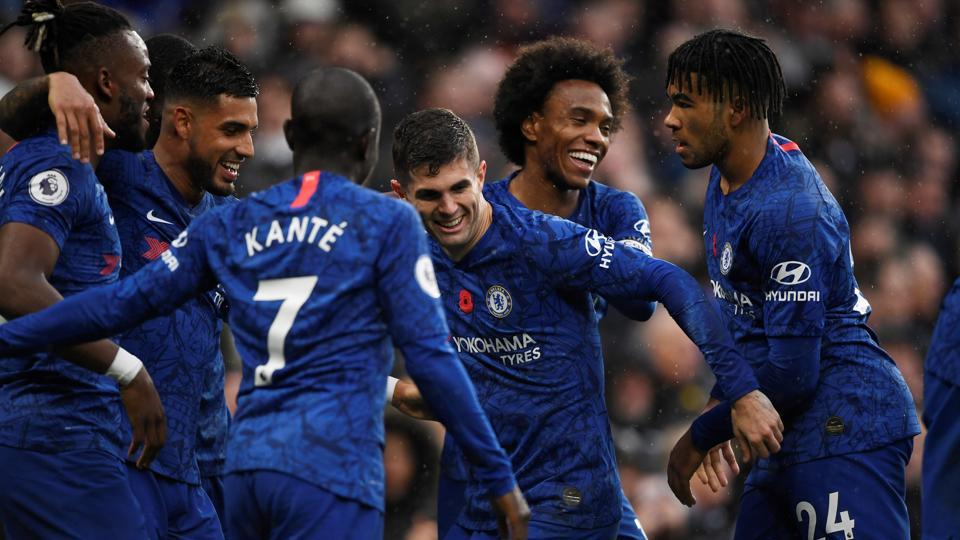 Chelsea's Christian Pulisic celebrates scoring their second goal with Willian and teammates.