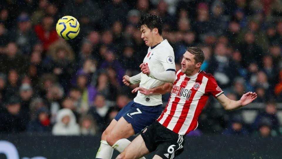 Sheffield United's Chris Basham in action with Tottenham Hotspur's Son Heung-min Action.