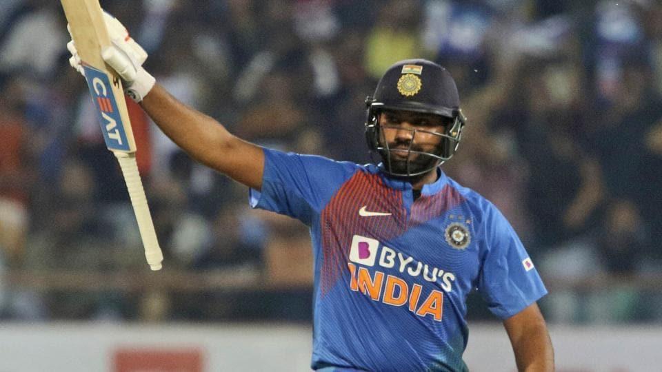 India's captain Rohit Sharma, celebrates his fifty.