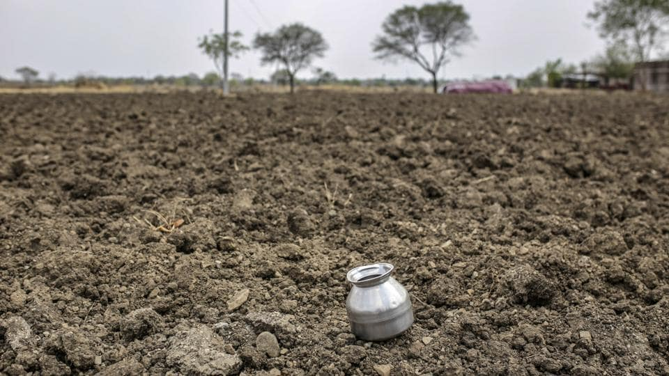 A water vessel sits on farmland near the village of Khardewadi in this aerial photograph taken in Beed district, Maharashtra.