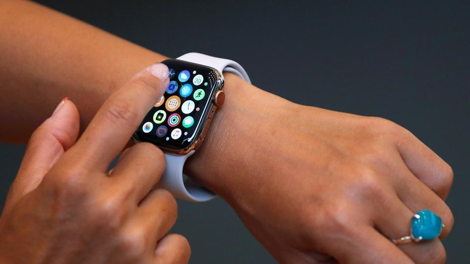 A customer checks Apple's new Apple Watch Series 4 after it went on sale at the Apple Store in Tokyo's Omotesando shopping district, Japan, September 21, 2018.