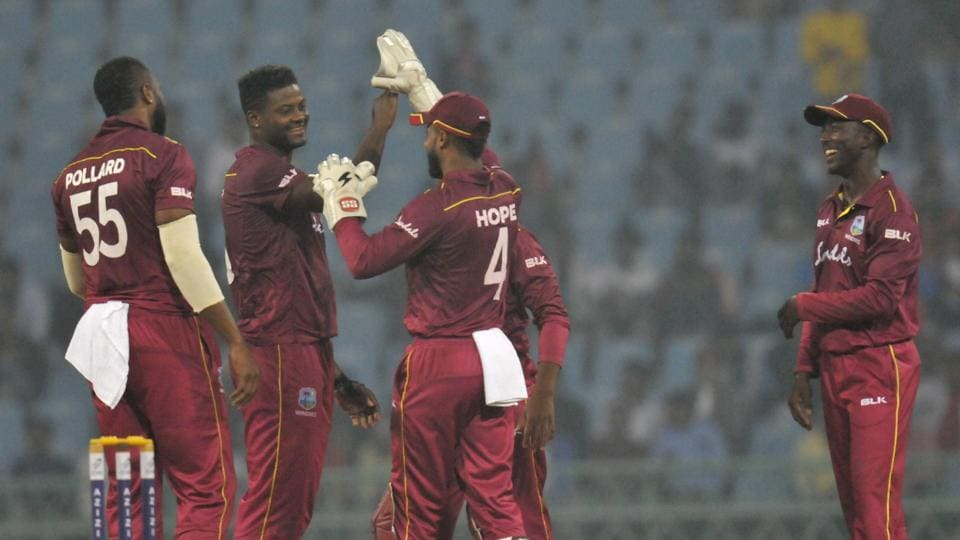 West Indies players celebrate after defeating Afghanistan during their 1st ODI cricket match at Ekana International cricket stadium, Lucknow.