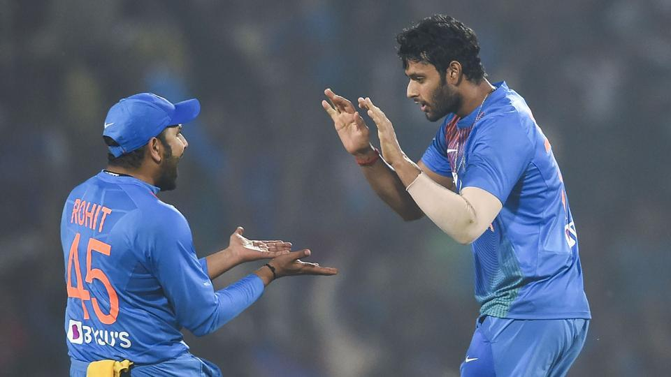 Indian players Rohit Sharma and Shivam Dube celebrate the dismissal of Bangladesh's Mushfiqur Rahim