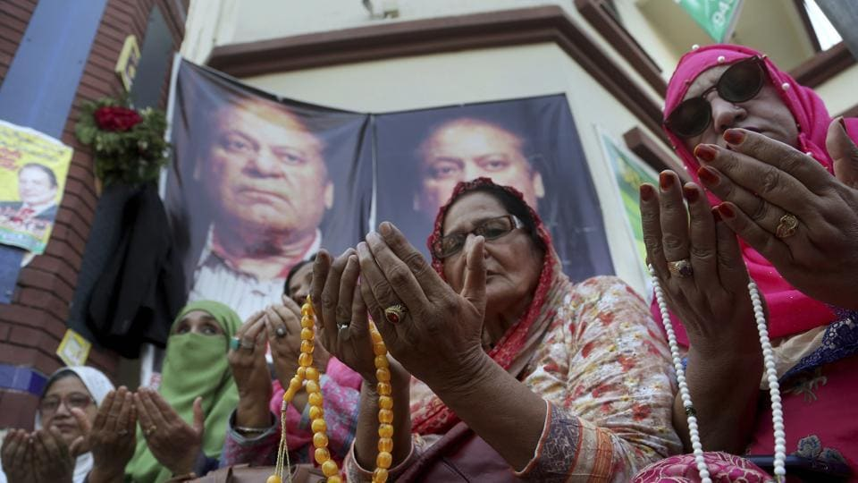Supporters of Pakistan's former Prime Minister Nawaz Sharif pray for health of their leader outside a hospital where Sharif is admitted, in Lahore.