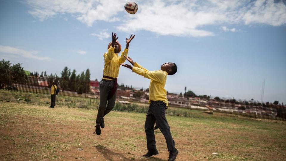 Players from the Soweto Rugby School Academy warm up before practice in Soweto. These players are part of the Soweto Rugby School Academy (SRSA), one of the three rugby schools of Soweto, a black township of Johannesburg housing more than 1.3 million people. Founded in 2016 the SRSA  has some 250 students of age between 8 and 19, of which almost 50 are girls. (Guillem Sartorio / AFP)