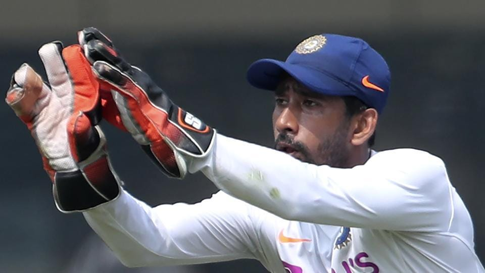 India's Wriddhiman Saha prepares to catch the ball during a training session.