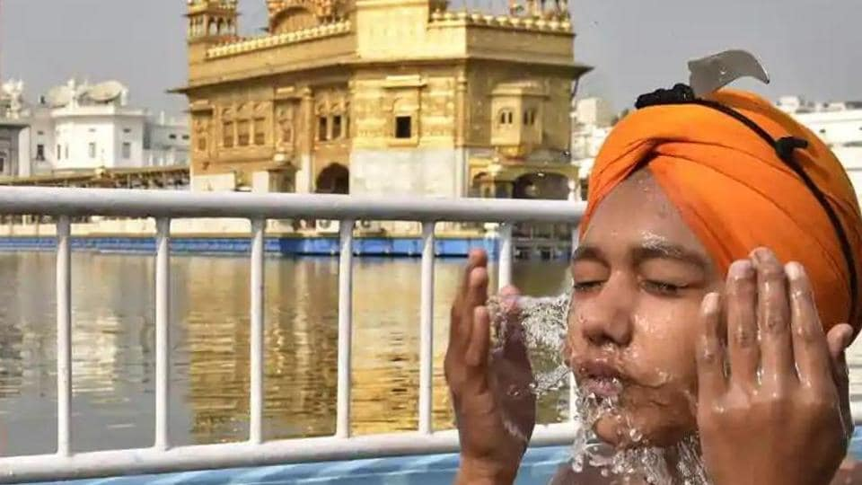 A devotee takes a dip in the holy sarovar (pond) at the Golden Temple, Amritsar.