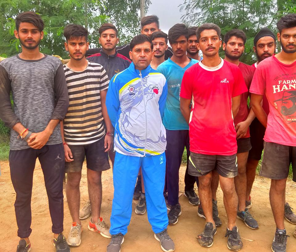 Jitender Singh Charak (centre) with his trainees in Bishnah tehsil of Jammu district.