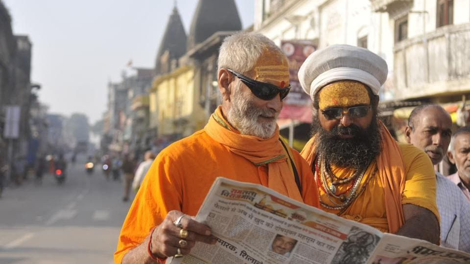 Ayodhya, India – November 10, 2019: Sadhus read a newspaper, a day after the Ayodhya verdict, in Ayodhya, Uttar Pradesh, India, on Sunday, November 10, 2019. (Photo by Deepak Gupta/ Hindustan Times)