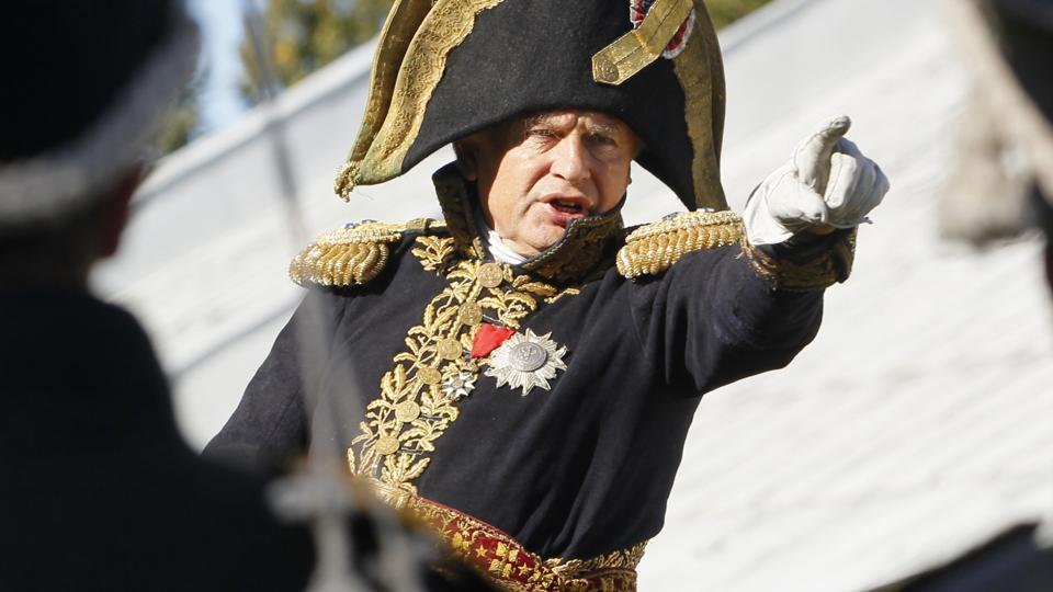 Oleg Sokolov, a history professor at St. Petersburg State University, wears a 1812-era French army general's uniforms during a staged battle re-enactment to mark the 200th anniversary of the battle of Borodino.