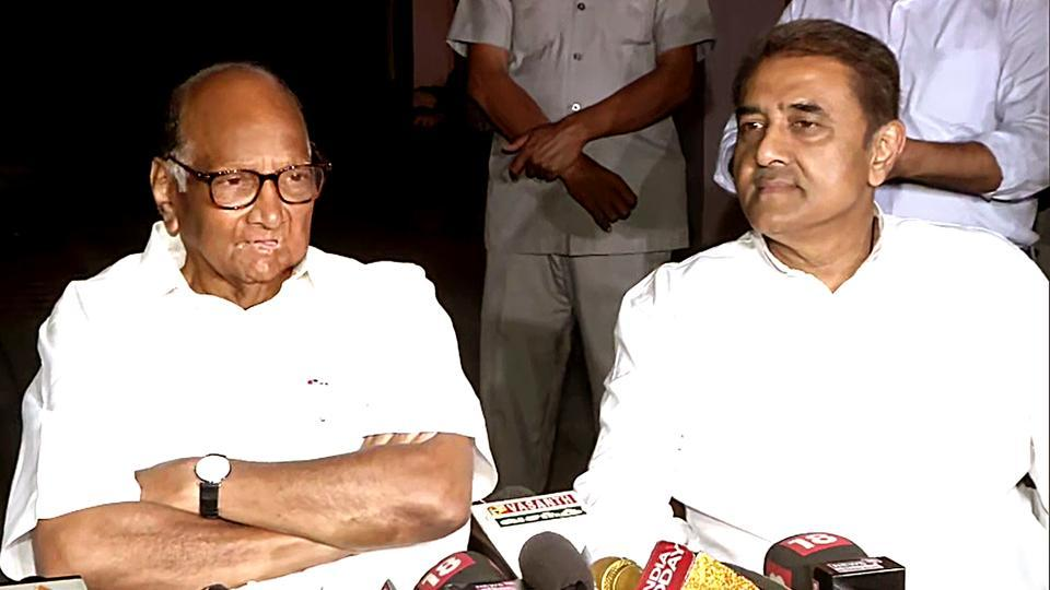 New Delhi, Nov 04 (ANI): NCP Chief Sharad Pawar and President of Maharashtra Pradesh Congress Committee Ashok Chavan during a press conference in New Delhi on Monday. (ANI Photo)