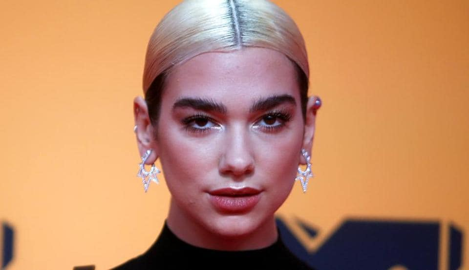 Dua Lipa poses on a red carpet as she arrives at the 2019 MTV Europe Music Awards at the FIBES Conference and Exhibition Centre in Seville, Spain, November 3, 2019. (REUTERS)