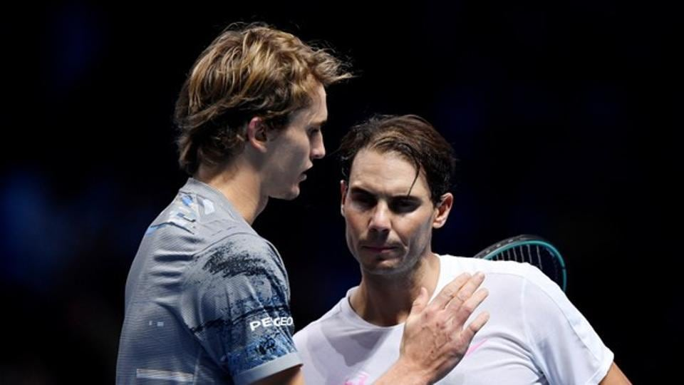 Germany's Alexander Zverev with Spain's Rafael Nadal after winning their group stage match.