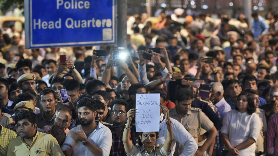 Delhi police personnel hold placards as they gather outside police headquarters to protest against the alleged attack by lawyers at Tis Hazari and Saket courts, New Delhi, November 5, 2019