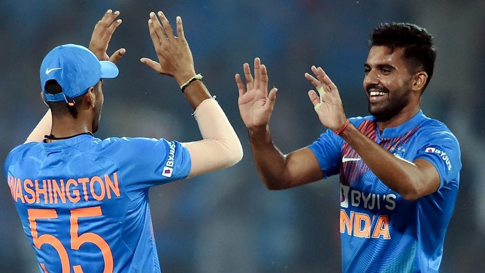 Deepak Chahar celebrates with teammate Washington Sundar.