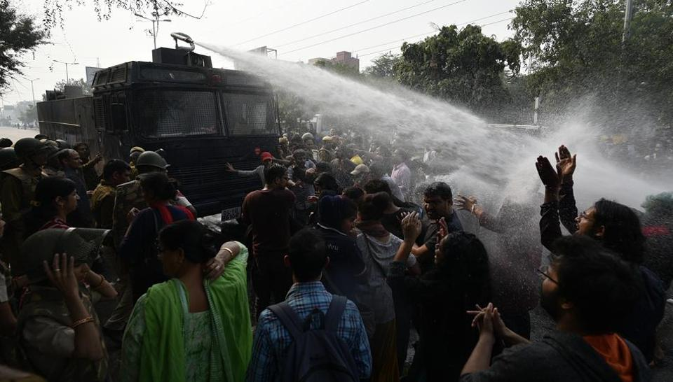 Students of Jawaharlal Nehru University (JNU) are fired upon by a water cannon during a protest outside the All India Council for Technical Education during the JNU convocation, against fee hikes, in New Delhi, India, on Monday, November 11, 2019.