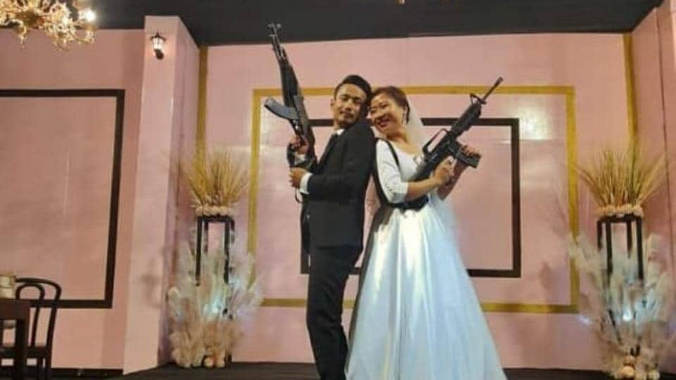 A young couple who posed with automatic assault rifles at their wedding reception in Nagaland's commercial hub Dimapur last week was arrested on Wednesday. They were later released on bail.