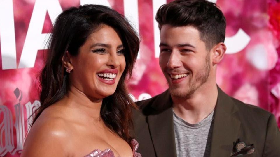 Priyanka Chopra and husband Nick Jonas pose at the premiere for the movie Isn't It Romantic.