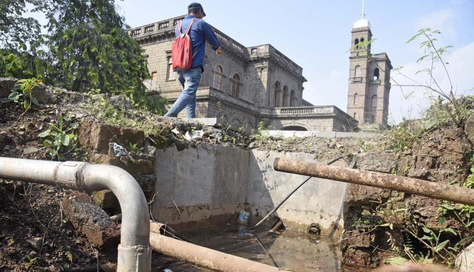 Dirty water collected    at an open space on SPPU campus. Potholes, small ponds and open gutters spread dengue as they are a breeding ground for mosquitoes.