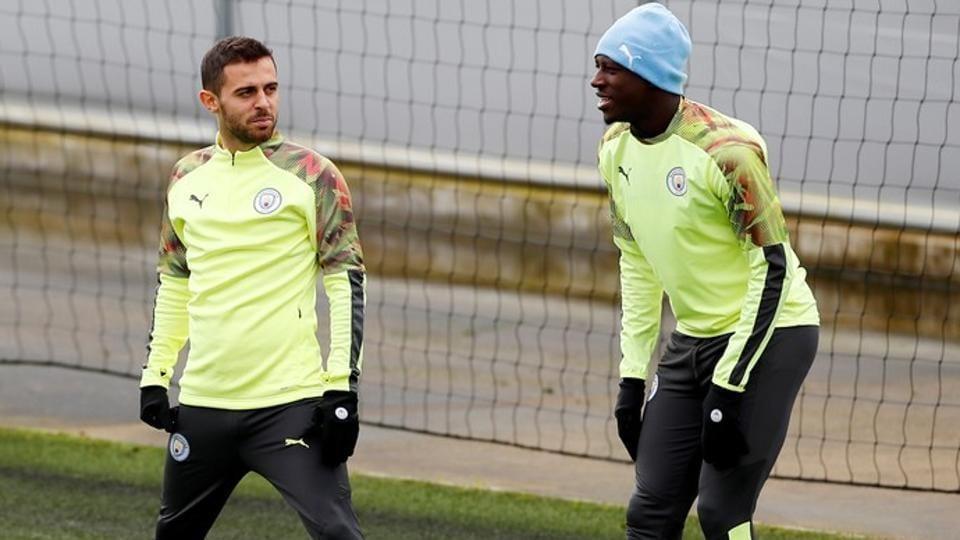 Manchester City's Bernardo Silva and Benjamin Mendy during training.