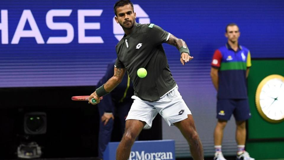 Sumit Nagal of India hits to Roger Federer of Switzerland.