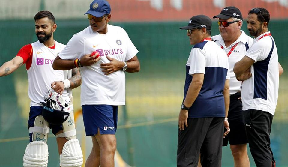 Indian skipper Virat Kohli and Head Coach Ravi Shastri (L) during a practice session.