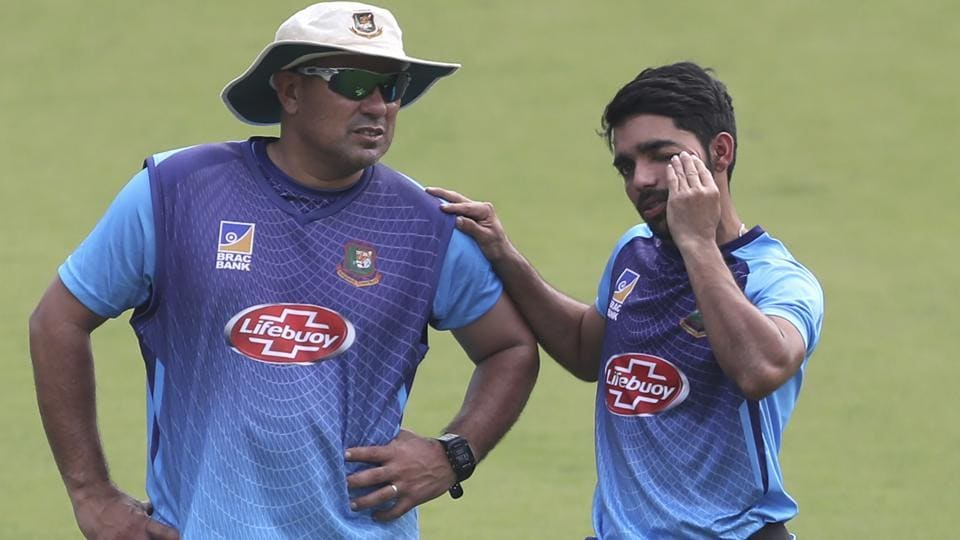 Bangladesh's captain Mominul Haque, right, interacts with head coach Russell Domingo.