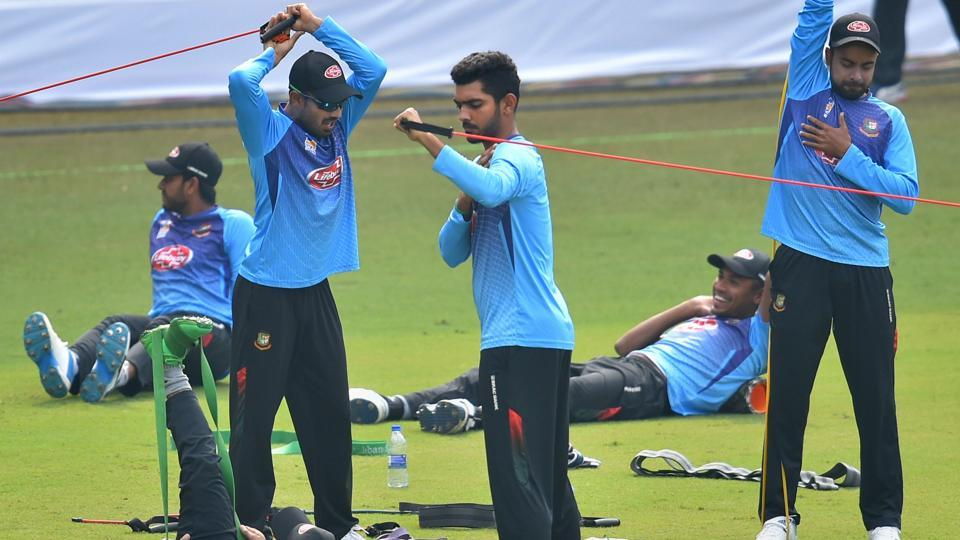 Bangladesh cricketers (L-R standing) Mohammad Mithun, Saif Hassan and Abu Jayed during a practice session.