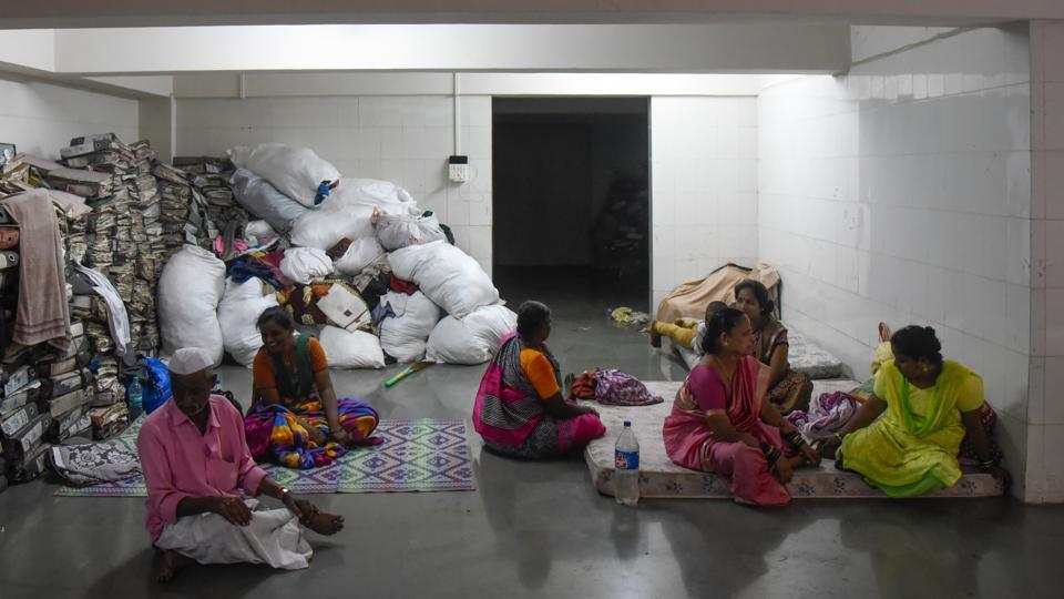 Affected residents of Tangewala colony take shelter at Kamgar Kalyan hall after the flash floods.