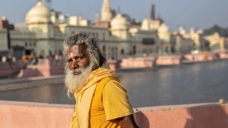 A priest leaves after performing prayers on the banks of Sarayu river after Supreme Court's verdict on  Ayodhya,  November 11, 2019.