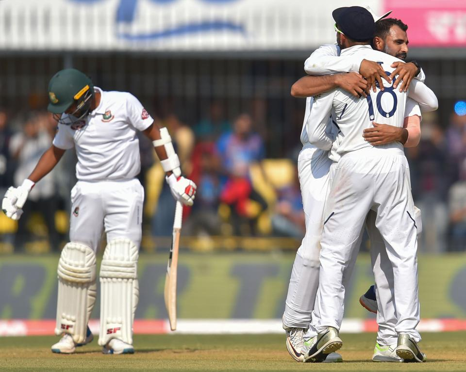 Indian bowler M Shami hugs captain Virat Kholi after taking the wicket of Bangladesh batsman M Hasan. (PTI)