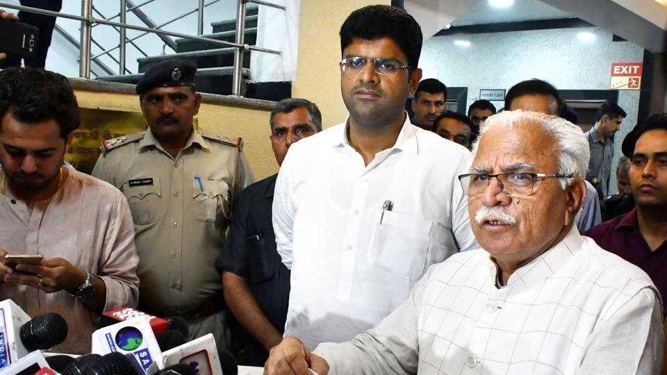 Haryana Chief Minister Manohar Lal Khattar speaks during a press conference after a meeting as Deputy Chief Minister Dushyant Chautala looks on, at Haryana Bhawan in New Delhi.