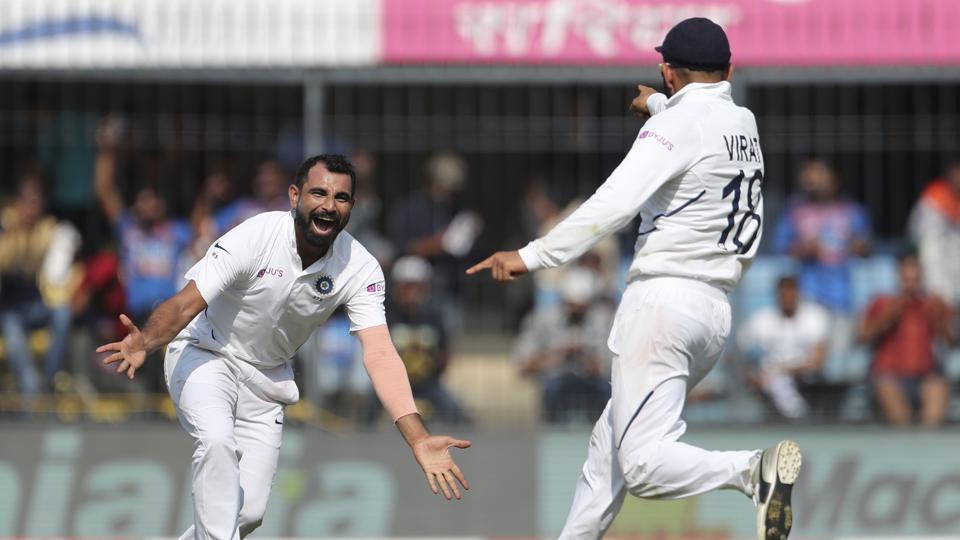 India's Mohammed Shami, left, celebrates with captain Virat Kohli the dismissal of Bangladesh's Mushfiqur Rahim during the first day of first cricket test match between India and Bangladesh in Indore, India, Thursday, Nov. 14, 2019. (AP Photo/Aijaz Rahi)