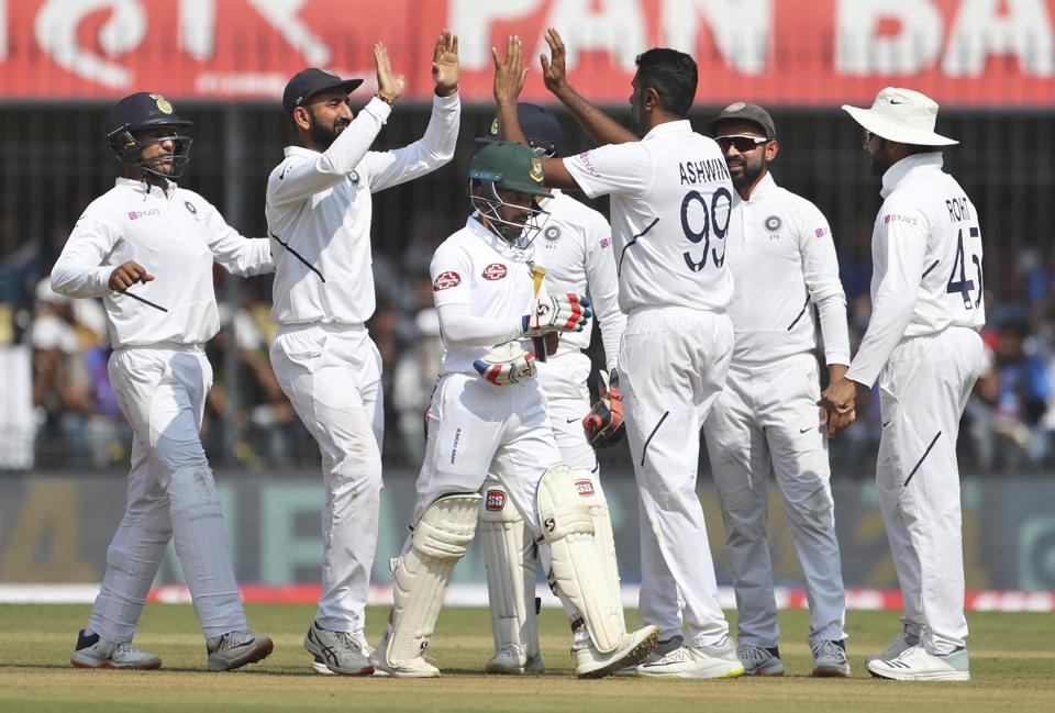 India's Ravichandran Ashwin, third right, celebrates with teammates the dismissal of Bangladesh's captain Mominul Haque. (AP)