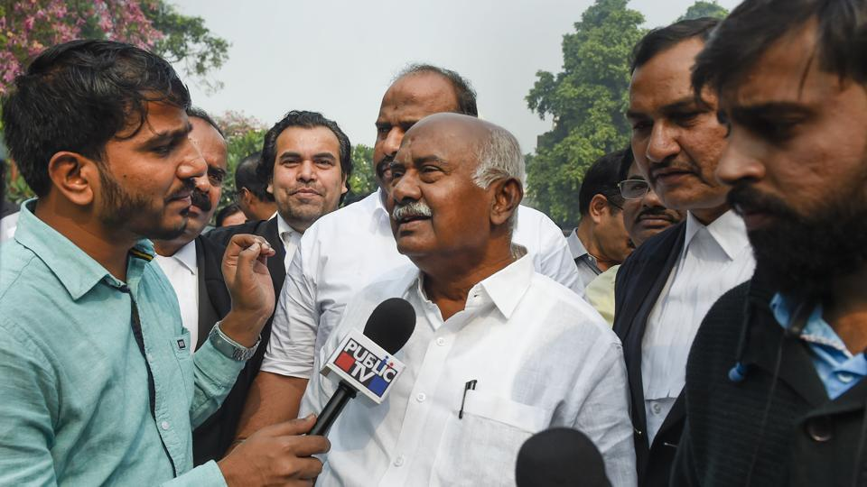 Former Lok Sabha MP Adagur H Vishwanath speaks to media personnel after Supreme Court announced its verdict on former Karnataka Speaker's order disqualfying 17 MLAs, in New Delhi on Wednesday.