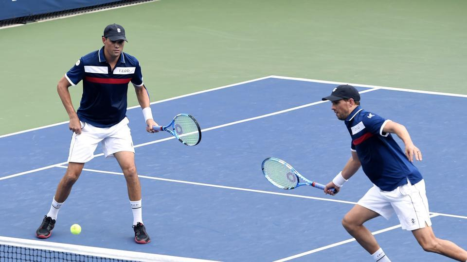 File image:Mike Bryan, left, returns a shot as his brother Bob Bryan, looks on