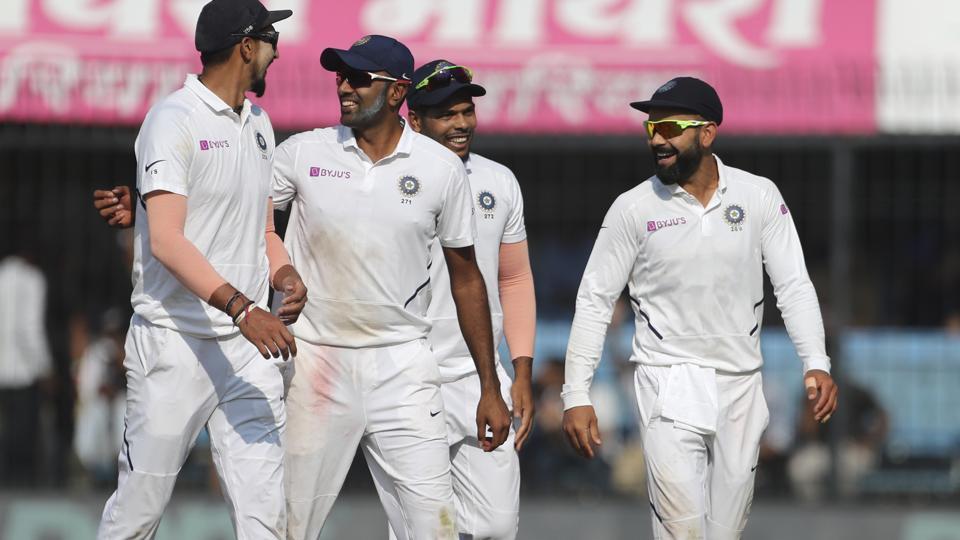 India's captain Virat Kohli, right, celebrates with teammates.