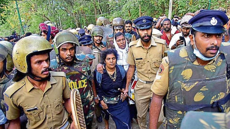 Bindu Ammini and Kanaka Durga are escorted by police after they attempted to enter the Sabarimala temple in Pathanamthitta district in Kerala.