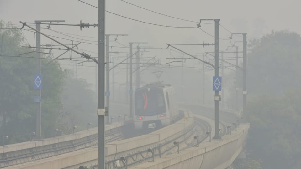 Airport Metro train moves in thick smog, November 15, 2019