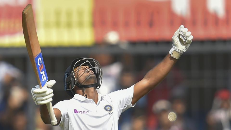 Indore: Indian batsman Mayank Agarwal holds up his bat as he reacts after scoring a century