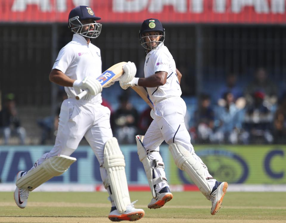 India's Mayank Agarwal, right, and batting partner Ajinkya Rahane run between the wickets to score during the second day of first cricket test match between India and Bangladesh in Indore.