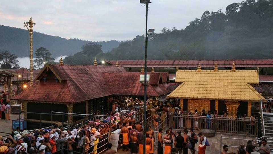 Hindu devotees wait in queues inside the premises of the Sabarimala temple in Pathanamthitta district in Kerala.