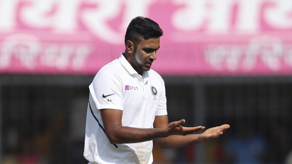 India's Ravichandran Ashwin looks at his hands after bowling a delivery during the first day of first cricket test match between India and Bangladesh in Indore, India, Thursday, Nov. 14, 2019.