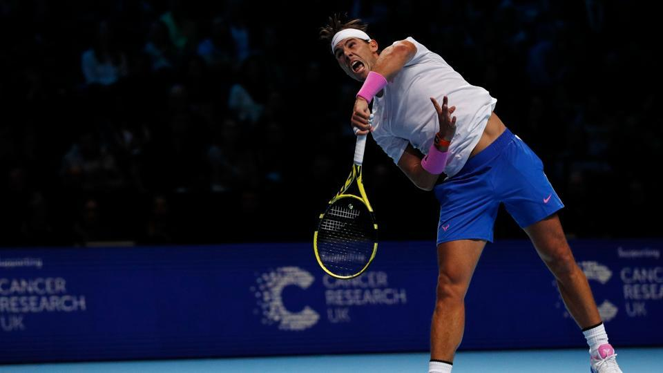 Spain's Rafael Nadal serves against Russia's Daniil Medvedev during their men's singles round-robin match on day four of the ATP World Tour Finals tennis tournament at the O2 Arena in London. (Adrian DENNIS / AFP)