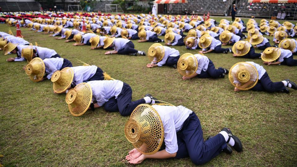Thai students hold a rehearsal at a school ground in Bangkok on November 13, 2019 in preparation for Pope Francis' visit.  (CHALINEE THIRASUPA / AFP)