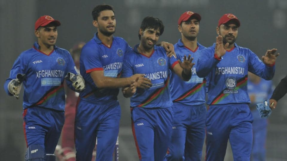 Karim Janat (centre) is being congratulated by team mates after he took five wickets in the second T20 match against West Indies in Lucknow on Saturday.
