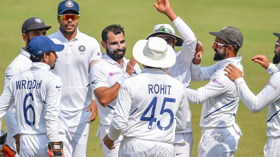 Indian bowler M Shami (C) celebrates the wicket of Bangladesh batsman Mahmudullah.
