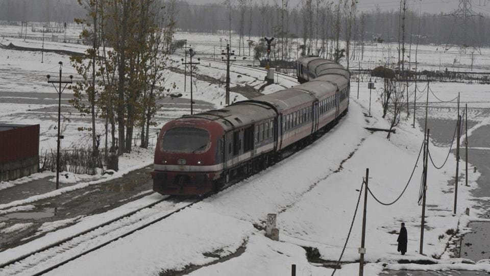 A train crosses a snow-covered railway track in Narbal area, some 30 kilometres from Srinagar, Jammu and Kashmir. The government conducted a trial run of the inter-district rail services in Kashmir. The service remained shut since August 05, 2019. (Waseem Andrabi / HT Photo)