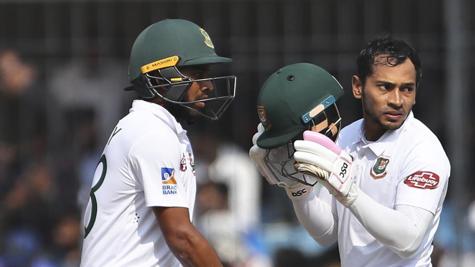 Bangladesh's Mushfiqur Rahim, right, and Mehidy Hasan stand between the wickets.